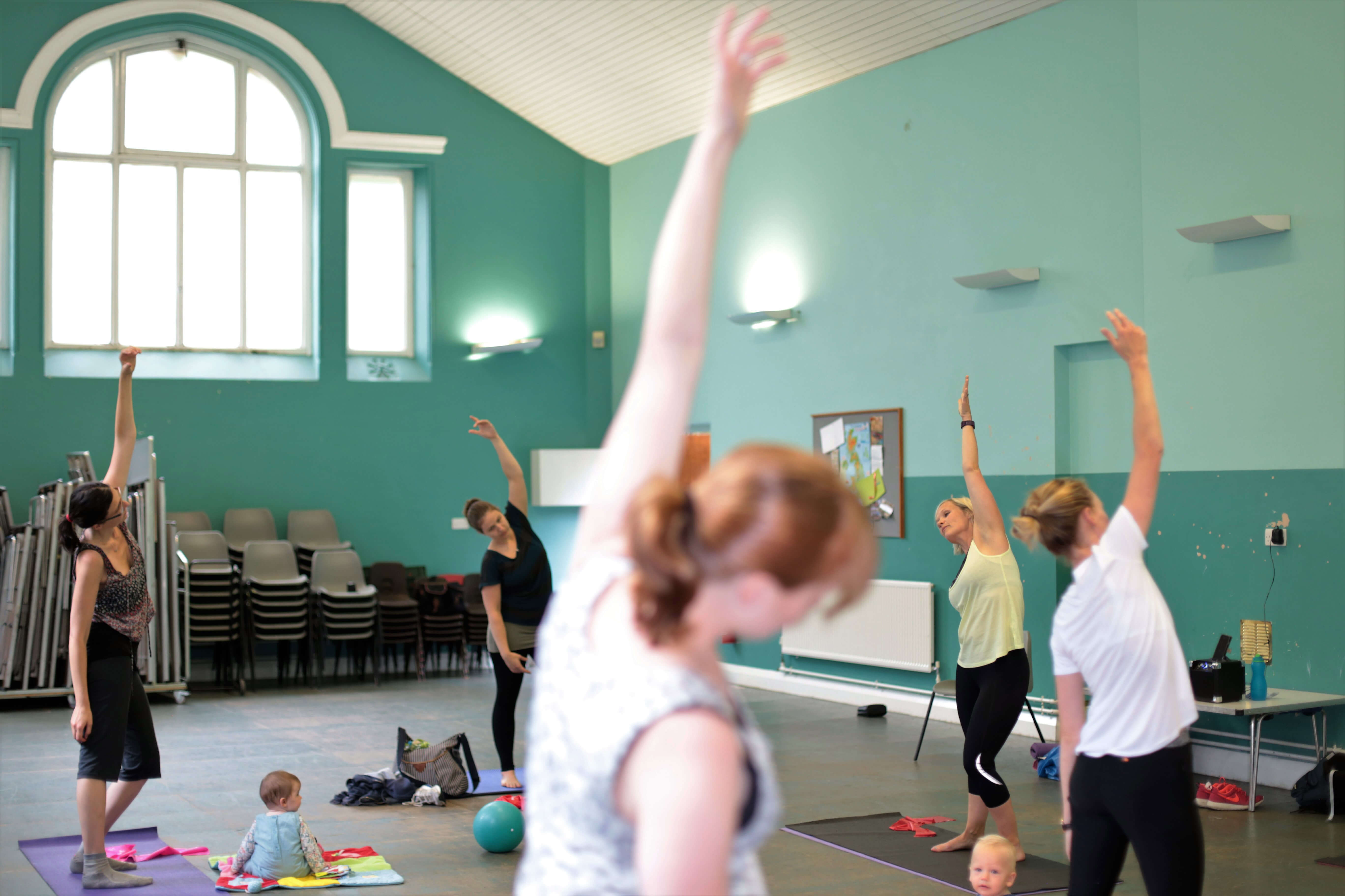 Pilates group shot of women with babies.
