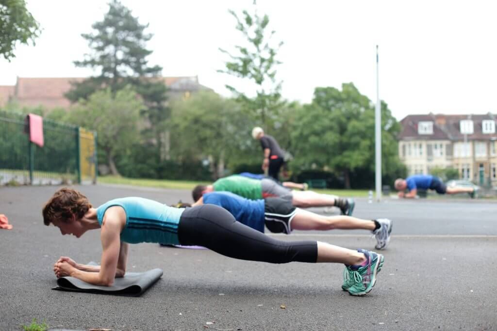 At bootcamp class doing a plank exercise.